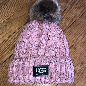 Pink cable stitch hat with Pom Pom